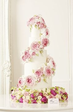 Featured Cake: Peggy Porschen Cakes; Perfect pink peony wrapped white wedding cake