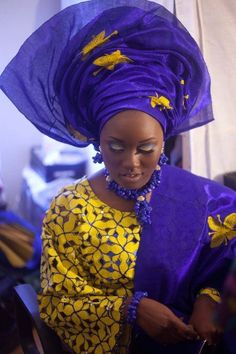Love, love, love her blue headwrap! What lovely fabric!...