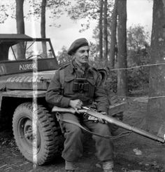 Aurore Jeep Major Jacques Ostiguy of Le Régiment de Maisonneuve, who has just been decorated with the Distinguished Service Order, Ossendrecht, Netherlands, 17 October 1944 Raymond Loewy, Ski Doo, Automobile, Canadian Army, Ww2 History, Illustrations, World War Ii, Wwii, Sunrises