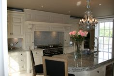 Stunning Hand painted kitchen with lots of intricate details such as classic style doors pilasters and cornice