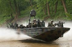 PHOTOS: Inside The Secret World Of Navy Seals A SOC-R from the Special Boat Team moves at high rate of speed down a narrow waterway as SWCC operators man their weapons.  Photo: Greg E. Mathieson Sr. / NSW Publications