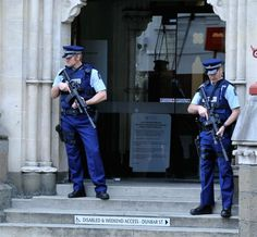 New Zealand armed police stand outside the main entrance to the Dunedin courthouse for court proceedings of a gang leader