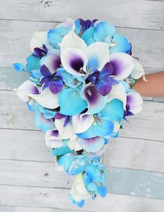 This is a beautiful -almost fresh- Turquoise Aqua Calla Lilies, Picasso Calla Lilies and Purple Blue Orchids, made with the most realistic silk flowers available. We can add other colors or flowers if youd like, just convo us. Will be finished with any ribbon color youd like. Default will be