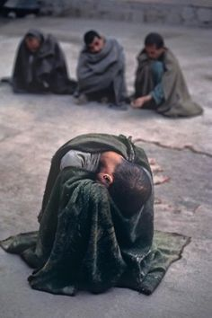 "rwa42:    Insane asylum, Kabul, Afghanistan    ""The pain of war has become too much for these men. Wrapped in blankets, they have retreated into themselves. Vulnerable and haunted by demons, they are the uncounted casualties of decades of war.""    - Steve McCurry"