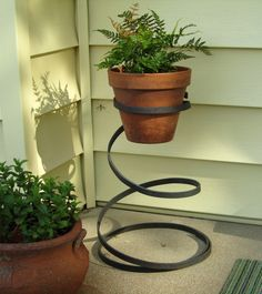 Plant Stand, Forged Iron Spring, Vintage Metal Art. 70.00 via Etsy. 22 inches high.