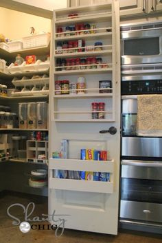 Pantry Organization!! Free plans on how to build your own space saving storage area on the back of your pantry door.