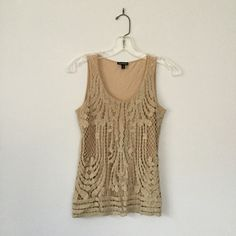 Express Champagne Gold Crochet Top Dress up any outfit with this gorgeous piece. Small hole on the bottom of the inner nude layer that has been treated and is unnoticeable -- see last photo with dime for size reference. Express Tops Tank Tops