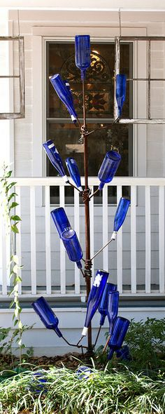 Gullah Bottle Tree  -  South Carolina Artisans Center, 318 Wichman StWalterboro, SC.  Tradition holds that evil spirits are captured in the bottles before they can invade the gallery.  When the wind blows, the low howl of the nasty spirits can be heard from the bottle tree.