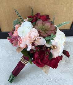 A stunning addition to make your special day one to remember. This beautiful silk/real touch bouquet not only looks fresh and realistic but will be a keepsake for a lifetime without the worries of wilting fresh flowers. This gorgeous bouquet was handmade in shades of blush, dusty rose,