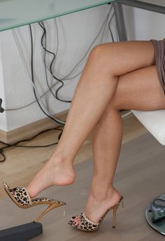 Animal Print Mules, arches, and great legs.