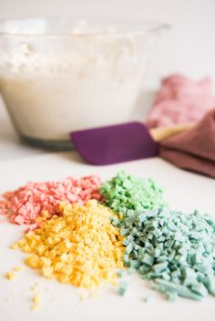 Colorful pastel rainbow chips in piles to be stirred into a vanilla cream cheese frosting base to make rainbow chip frosting. Vanilla Cream Cheese Frosting, Fluffy Frosting, Frosting Recipes, Cake Recipes, Rainbow Chip Frosting, Funfetti Cake, Sweet Tooth, Cooking Recipes, Chips
