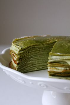 Stack matcha crepes high for a beautiful green tea crepe cake, layered with delicious green tea pastry cream. Green Tea Recipes, Sweet Recipes, Cake Recipes, Dessert Crepes, Matcha Dessert, Tea Cakes, Cupcake Cakes, Green Tea Crepe Cake, Funnel Cakes