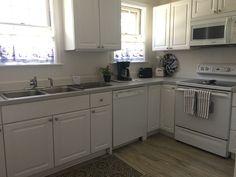 Brightwaters: Garden - Vacation Home in Hendersonville House On The Rock, Kitchen Cabinets, Vacation, Home Decor, Vacations, Decoration Home, Room Decor, Kitchen Cupboards, Interior Design