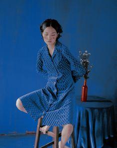 This photo is interesting. everything is blue except for the skin, hair, vase, and cheeks. The vase and cheeks are the same color which helps the eye bounce back and forth between the two figures.   by Rala Choi