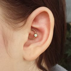xbrainflowerpiercingx: Fresh daith with niobium cbr from and white opal from anodized rose gold in house! Cute Ear Piercings, Daith Piercing, Body Jewelry, Jewellery, Body Modifications, Cbr, White Opal, Rose Gold, Jewels