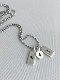 Dog Tag Necklace, Stamped Metal Initial Charm, Sterling Silver Letter Pendant Necklace, Small Charm Necklace for Couples / Boyfriends and Girlfriends on Etsy