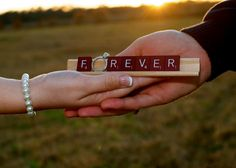 This is a really cute engagement/wedding picture idea <3