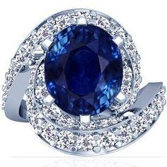 18K White Gold Oval Cut Blue Sapphire Ring With Sidestones, via https://myamzn.heroku.com/go/B00551T2X0/18K-White-Gold-Oval-Cut-Blue-Sapphire-Ring-With-Sidestones