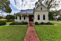 An opportunity to own a piece of history in Comfort. Stunning 4/2, on a pristine corner lot, fenced with gated entrance. Enjoy morning & evening on the large front porch. The interior is graced with high ceilings, architectural detail,& gorgeous floors. Well-appointed baths and kitchen make entertaining & family life enjoyable. Guest house is the perfect retreat for those looking to get away for the weekend and could be used as a B&B. Children adore the spacious playhous...