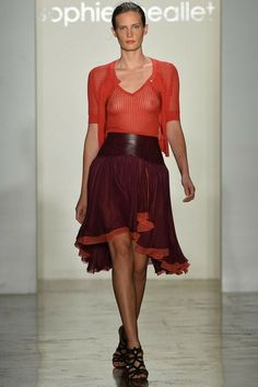 """Spring 2014 Ready-to-Wear Sophie Theallet /  """"Sensuality and seduction."""" That, according to Sophie Theallet, was the point of her Spring 2014 show. And you didn't need the designer to spell it out for you, either. Right off the bat, with a first look all in red tones that featured a clingy sheer knit top and a skirt with flounces fit for flamenco, she established a tone of ripe sexuality."""
