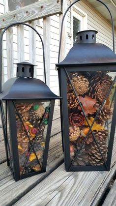 EASY Fall Home Decor that anyone can do! Buy some metal lanterns, add some pine cones, leaves, acorns, etc. then swap it out for each season.