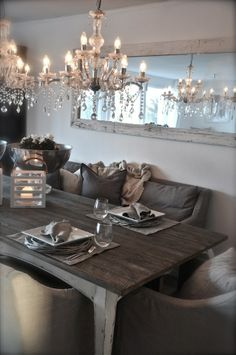 Chandeliers ,Big Mirror   ,Pillows And Dinner With Friends on a Beautiful Dining Table ,Ohhh Yeah .