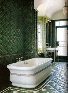 Large tub, green tiles, high ceiling...beautiful. Jed Johnson Interior Design