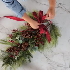 How to Make a Christmas Swag Wreath for Your Holiday Front Door - Celebrate t. - How to Make a Christmas Swag Wreath for Your Holiday Front Door – Celebrate the Season - Christmas Swags, Christmas Wreaths To Make, Holiday Wreaths, Christmas Holidays, Pinecone Christmas Crafts, Christmas Videos, Christmas Front Doors, Winter Wreaths, Burlap Christmas