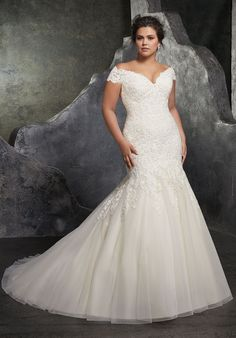 Mori Lee 3234 // COMING SOON! Book today :) Figure Flattering Tulle Mermaid with Crystal Beading and Sculptured Lace Appliqués Along Bodice. A Romantic Off-the-Shoulder Neckline and Covered Buttons Along the Back Complete the Look. www.thepradocollection.com #wedding | #bride | #weddingdress