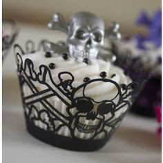 Black Skull Halloween Cupcake Wrapper....this is the coolest cupcake wrapper I have ever seen! I want to have a Halloween party just to serve these babies!