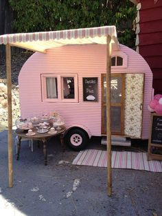 the prettiest pink old caravan selling cupcakes and pies. Tow behind the tiny house for food truck type business??