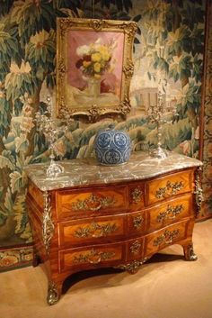 Louis XV commode and a lovely tapestry.