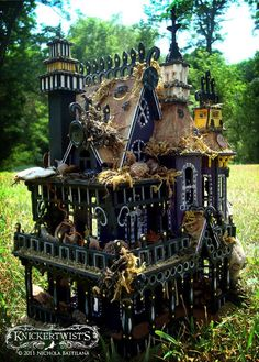 Halloween decorations - Take an old plastic doll house and turn it into a haunted house with spray paint and Halloween accessories! Description from pinterest.com. I searched for this on bing.com/images