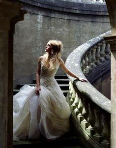 Messy wedding hair and an elegant dress. Love.