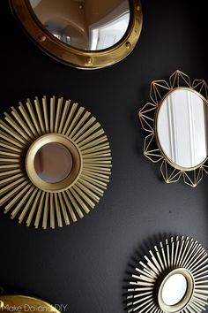 a black and gold wall of mirrors to add drama to the entry