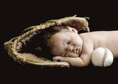 baby in a baseball glove. want to try with baby boy