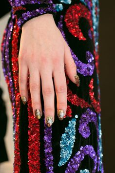 The nail look at Naeem Khan's Fall 2017 show. Photo: Imaxtree.   Gold nails are so trendy these days. Whether you like them matte with glitter or as tips on your French style polish ~ you are sure to get lots of heads turning sporting your fresh #golden #mani-pedi