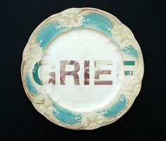 designer Karen Ryan works on second hand plates, removing 'the decorative patterns that camouflage our everyday lies'