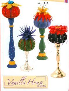 pincushion on a candle stick