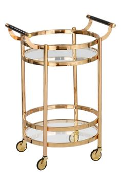 """- A polished goldtone bar cart with architectural railing details and double handles features removable glass trays for easy cleanup. - 20"""" x 24"""" x 34"""". - Some assembly required. - Glass/metal. - Hand"""
