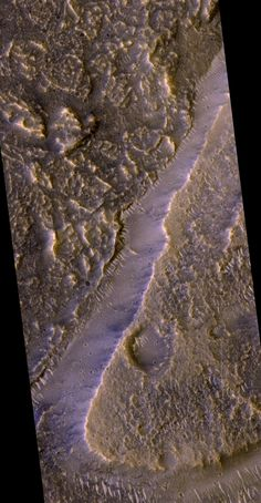 """""""Platey"""" material on the floor of Kasei Valles  This image covers an area about 2600 by 5000 meters in size. The valley is at upper left; its floor is covered with platey material. The platey material stops at the edge of a plateau or mensa at lower right, indicating that the platey material flooded the valley after it and the plateau formed. Solar System Exploration, Tenth Anniversary, Image Cover, Astronomy, Mars, Product Launch, Articles, Floor, Photos"""