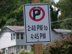 Very specific No Parking sign.