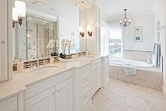 HGTV invites you to check out this elegant traditional bathroom featuring a double vanity, soaking tub and spa-like experience.