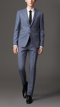 Burberry London Navy grey Slim Fit Silk Wool Suit - A slim fit suit with a short, closely fitted jacket and narrow tapered trousers crafted in a silk, wool and linen blend with a subtle flecked finish. The jacket has a full-canvas construction, cut and finished expertly by hand. Made with natural horsehair, the canvas creates a soft and refined drape throughout the jacket, whilst maintaining a lightweight structure in the chest and a soft roll in the lapel and collar.