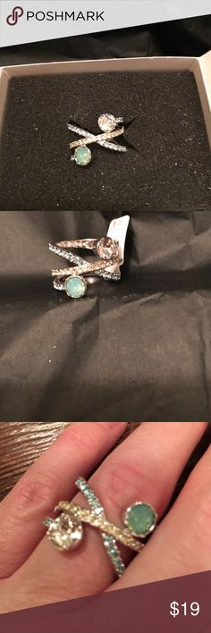 Lia Sophia 2 stone band ring Lia Sophia size 6 ring. Mint green and clear stone with criss cross stones in clear and gold color.  Back of band is solid. New never worn. Lia Sophia Jewelry Rings