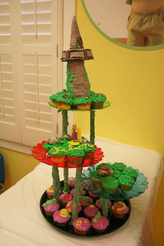"""""""Tangled"""" Rapunzel Tower Cake with cupcakes"""