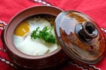 Sirene po shopski-Baked Cheese, eggs and Vegetables in small pottery pots.A traditional Bulgarian dish.