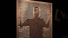 daniel rozin. wooden mirror (1999)  830 square pieces of wood, 830 servo motors, control electronics, video camera,  computer, wood frame.