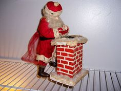 """Antique Santa Christmas Doll with music box chimney (total piece 12""""H x 5.5""""W)"""