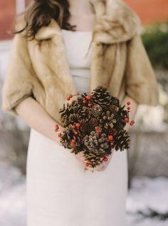 rustic winter pinecones wedding bouquet / http://www.deerpearlflowers.com/rustic-winter-pinecone-wedding-ideas/